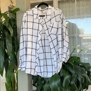A white with black strips flannel